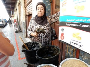 Our guide in Fes showing us some olive oil soap for the Hamam.