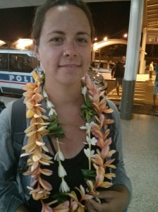 Dani wearing multiple leis